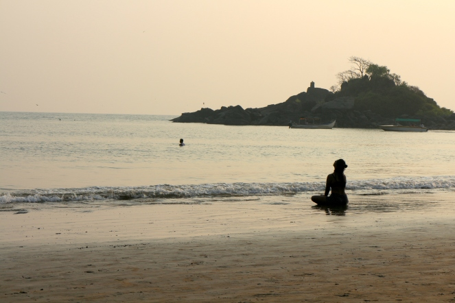 Women Meditating at Om Beach